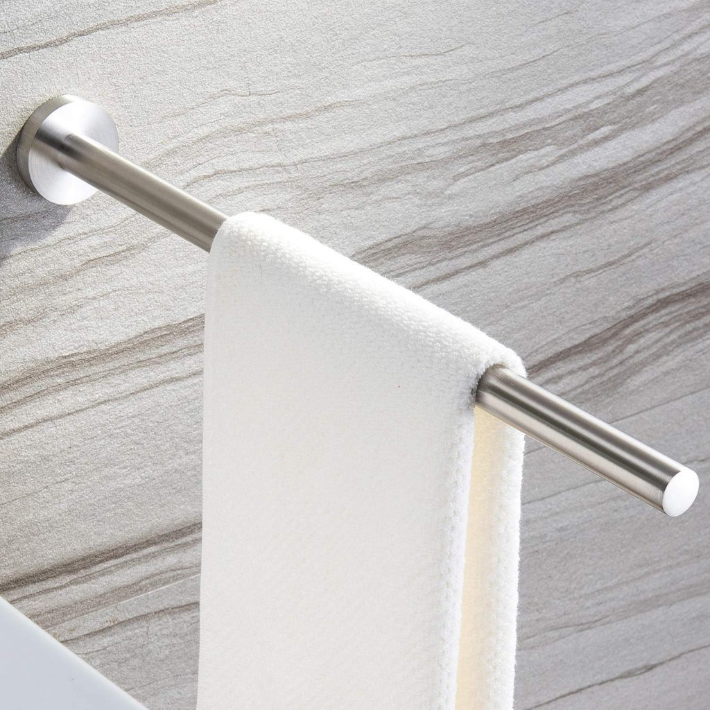 silver towel holder with a white towel