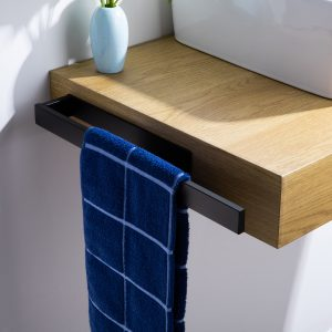 black towel rail with a blue towel